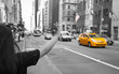 Tourist call a yellow cab in Manhattan with typical gesture