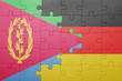 canvas print picture - puzzle with the national flag of germany and eritrea