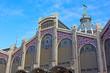 Central Mercado facade in Valencia, Spain. Intricate finishing of the market facade under the blue summer sky.