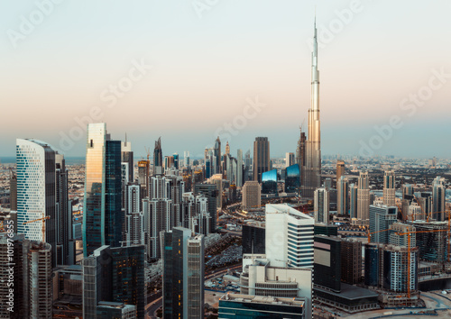 Fotografie, Obraz  Fantastic roofftop view of Dubai's business bay towers at sunset