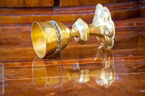 Fotografie, Obraz  Golden grail turned on wooden background