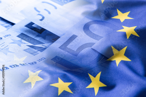 Garden Poster Northern Europe Euro flag. Euro money. Euro currency. Colorful waving european union flag on a euro money background.