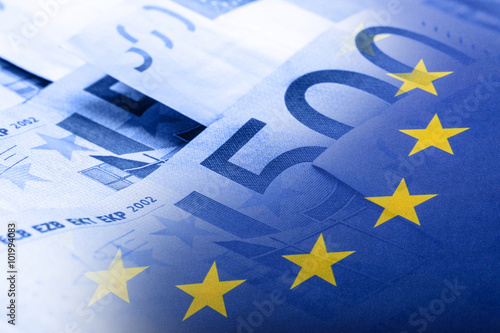 Wall Murals Northern Europe Euro flag. Euro money. Euro currency. Colorful waving european union flag on a euro money background.