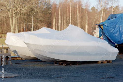 Valokuva  New boats in plastic casing