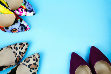 Three pairs of stiletto shoes in different patterns and colours on light blue background.