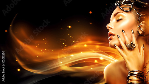 Poster - Burning woman head profile. Beauty fashion model girl with golden makeup