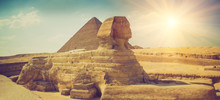 Panoramic View Of The Full Profile Of The Great Sphinx With The Pyramid In The Background In Giza.