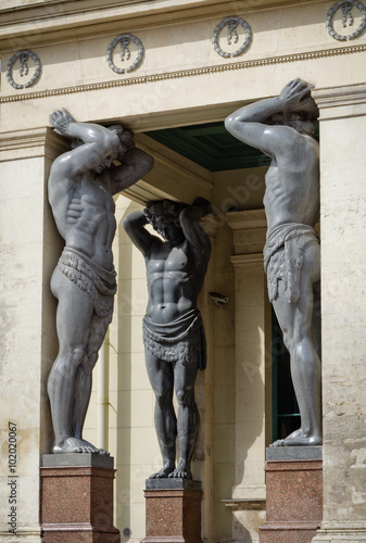 Photo Granite Atlantes (telamons) at New Hermitage in Saint Petersburg, Russia