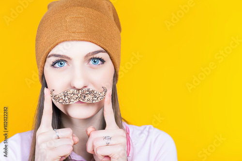 Photo  Funny teenage girl holding mustache for party