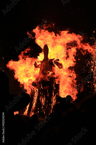 Traditional burning of Maslenitsa Scarecrow on seeing Russian winter on last day of Shrovetide in dark evening Canvas Print
