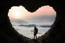 Hiker With Stick Pole Standing Inside Cave