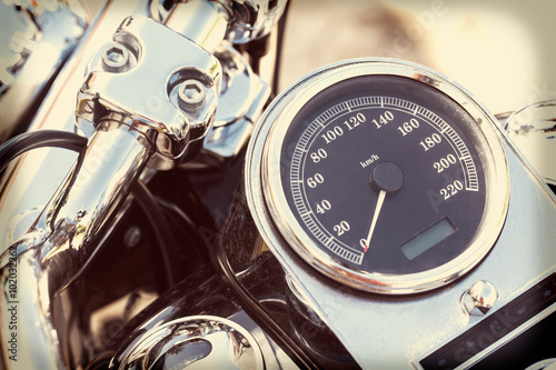 Motorcycle detail with mirror, speedometer and handlebar Poster