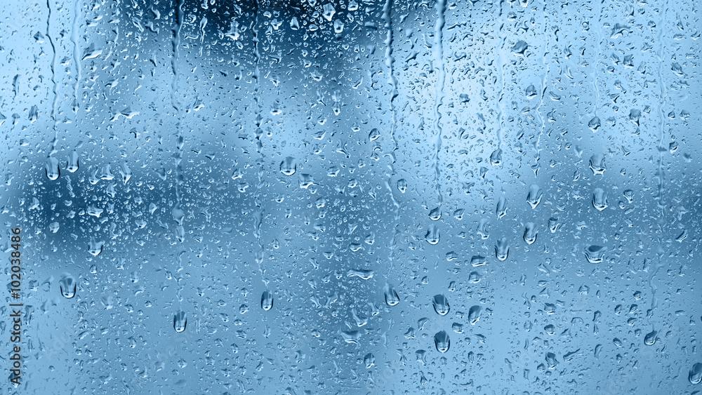 Fototapeta Raindrops on the window. Blue tone