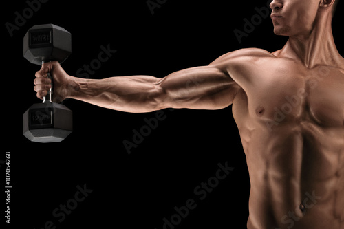 Fotografie, Tablou  Power athletic man pumping up muscles with dumbbell