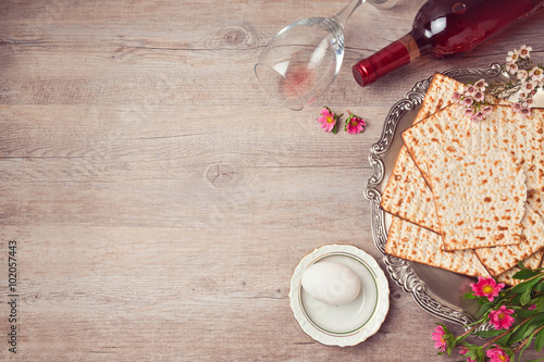Passover background with matzah, seder plate and wine. View from above
