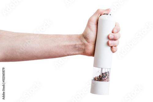 Fotografía  Hand holding modern white pepper grinder