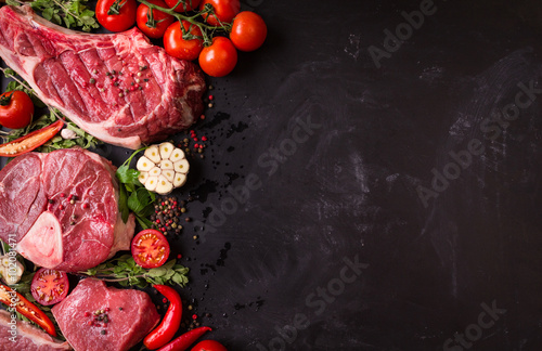 Door stickers Meat Raw meat steaks on a dark background ready to roasting