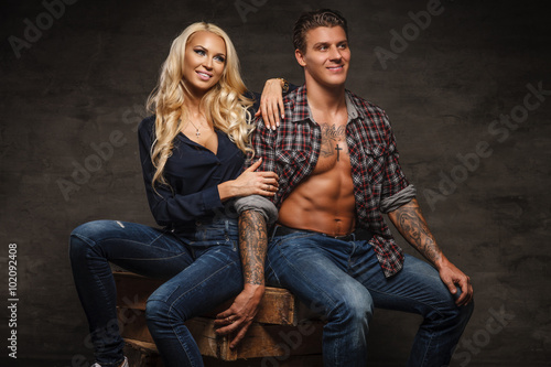 . Casual smiling couple of ...