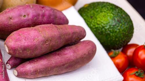 фотография  Japanese sweet potato with avocado and tomato