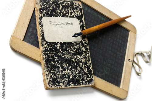 An old slate, penholder and exercise book, to learn write. Billede på lærred
