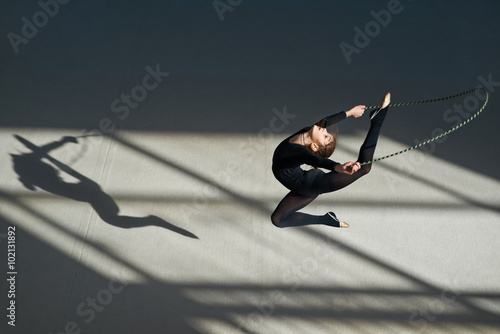 Foto op Canvas Gymnastiek Girl jumping rope