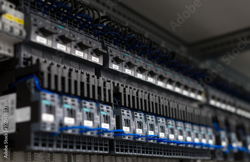 Photo  Close-up view of industrial contactors at factory.