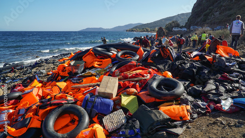 Canvas Print Abandoned belongings and life jackets on the Lesvos shore