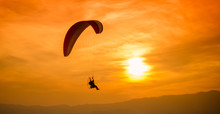 Silhouette Paraglider On Sunset