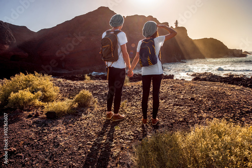 Fotobehang Diepbruine Young couple traveling nature