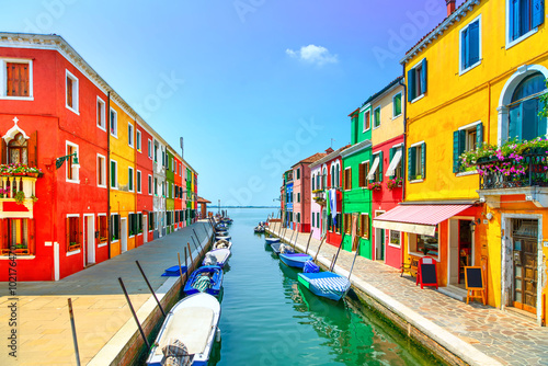 Fototapeta Venice landmark, Burano island canal, colorful houses and boats,