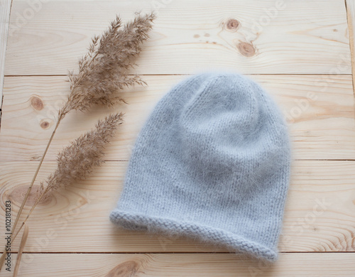 soft cap of blue angora bound by hand on natural wooden background Wallpaper Mural