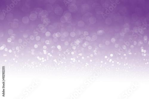 Purple glitter surface with purple light bokeh with white empty copyspace
