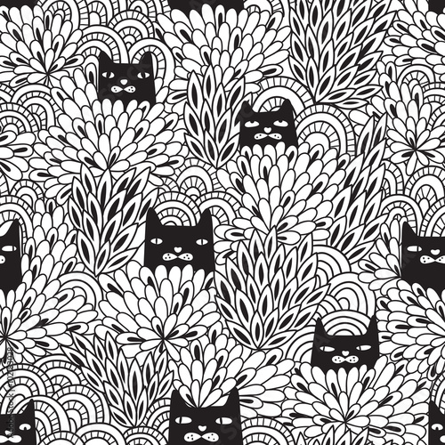Black cats looking out of the bushes. Seamless pattern