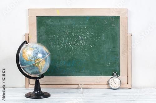 Photo  School board , globe and watches
