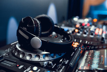 Headphones On Dj Board In Night Club