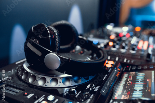 Photo  headphones on dj board in night club