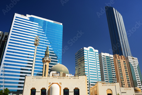 Canvas Prints Abu Dhabi Mosque on the background of skyscrapers in Abu-Dhabi