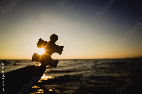 Valokuva  夕焼けの空とジグソーパズルのピース