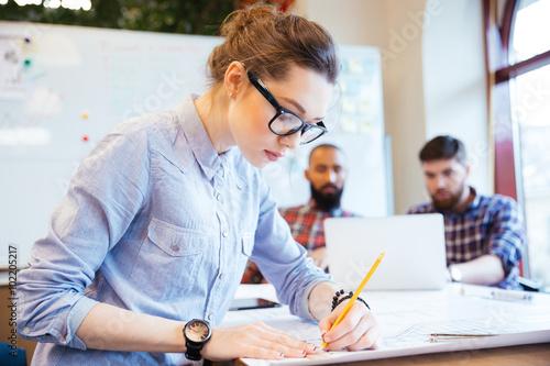 Fotografie, Obraz  Woman engineer working on blueprint