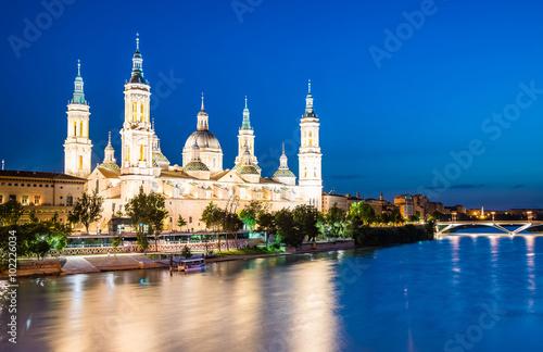 Our Lady of the Pillar Basilica with Ebro River at dusk Zaragoza