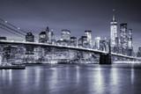 Fototapeta Nowy York - View of Manhattan  and  Brooklin Bridge by night, New York City