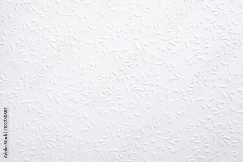 Obraz na plátně  White embossed paper with floral pattern