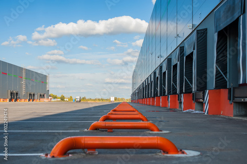 Staande foto Industrial geb. Cargo doors at big industrial warehouse building