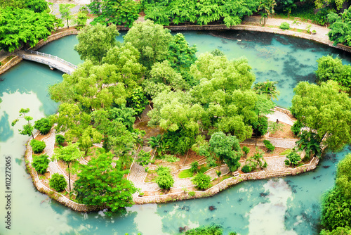 In de dag Lime groen Top view of isle in middle of lake at tropical garden, Vietnam