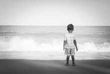 Rear Of Little Boy Stanging Looking The Sea,black And White Tone