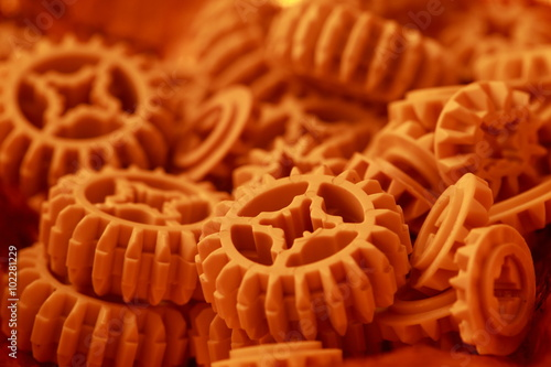 Fotografie, Obraz  Plastic orange  gears  texture .