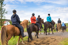Group Of Horseback Riders Ride...