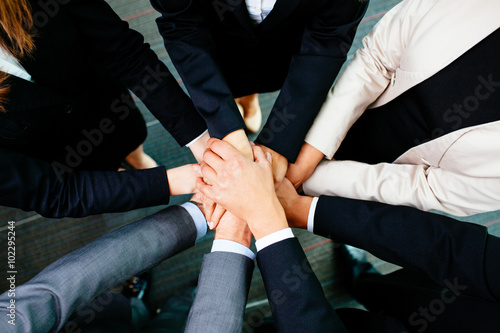 Fotografía  Overhead picture of business people joining hands