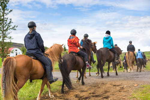 Photo  Group of horseback riders ride  in Iceland