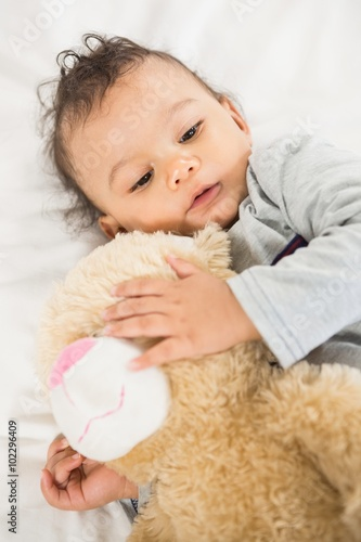 Cute baby holding plush Poster